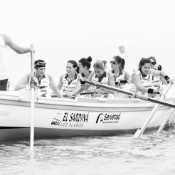 A crew of female rowers in a boat